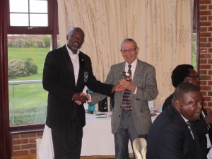 Mr. Tony Horswood receives prize from Captain of Nigerian United Kingdom Golfing Association (NUGA), Mr. Olumuyiwa Obileye.