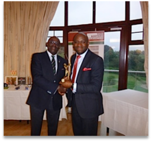 Mr. Kenny Adejolu receives prize from Mr. Tony Sokan, The President of Nigerian United Kingdom Golfing Association (NUGA)